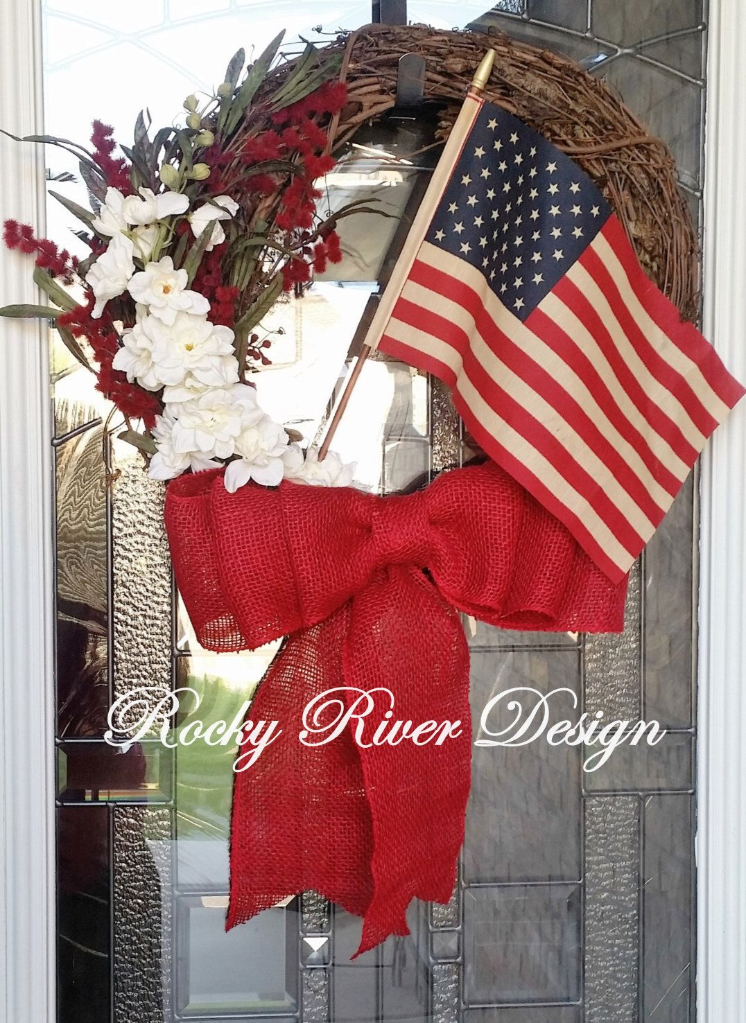 Americana Grapevine Wreath, American Flag, 4th of July, Floral Hanging, Independence Day, Red White and Blue, Tea Stained Flag, Patriotic by RockyRiverDesign on Etsy https://www.etsy.com/listing/399265781/americana-grapevine-wreath-american-flag