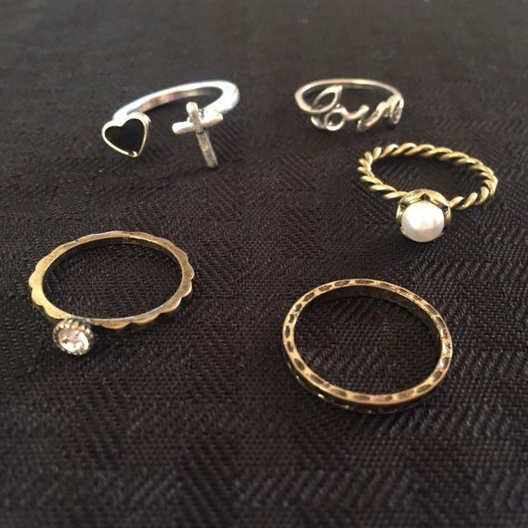 Lot of 5 rings from Maurices - 3 gold & 2 silver! Lot of 5 rings from Maurices - 3 gold & 2 silver! See pic, never worn! Size 7 I think but I don't know exactly. Maurices Jewelry Rings