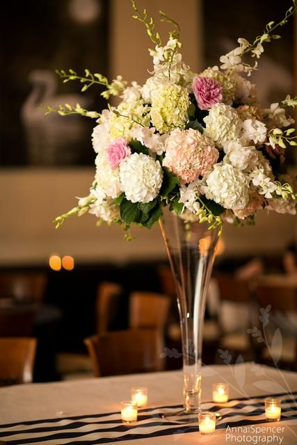 Centerpiece featuring dendrobium orchids peonies and