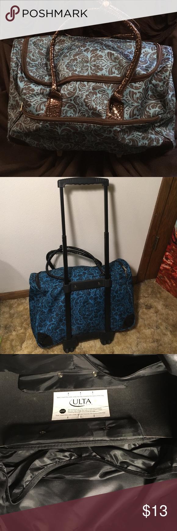 Teal weekend bag Cary on sized weekend bag with wheels. Mild wear. Ulta Bags Travel Bags