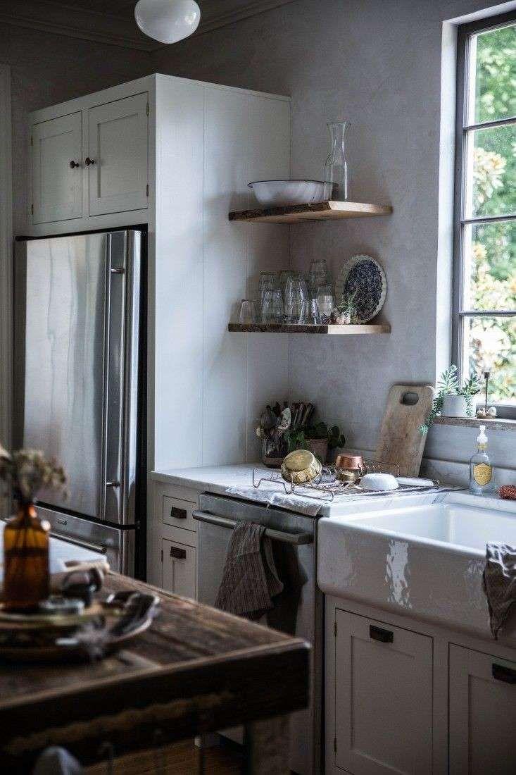 Idee colore pareti cucina - Parete color cemento