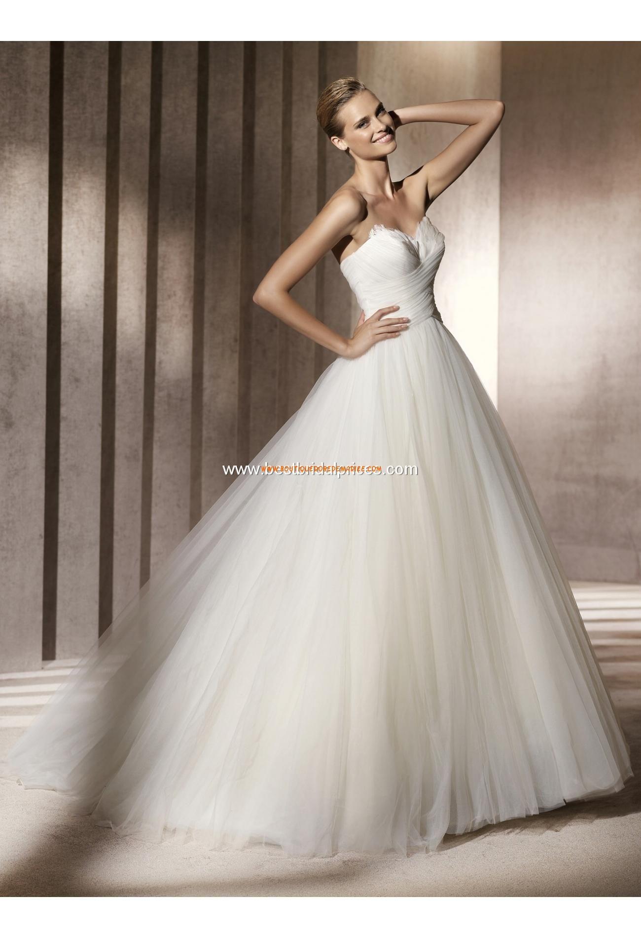 Robe de mariée princesse tulle bustier avec plumes