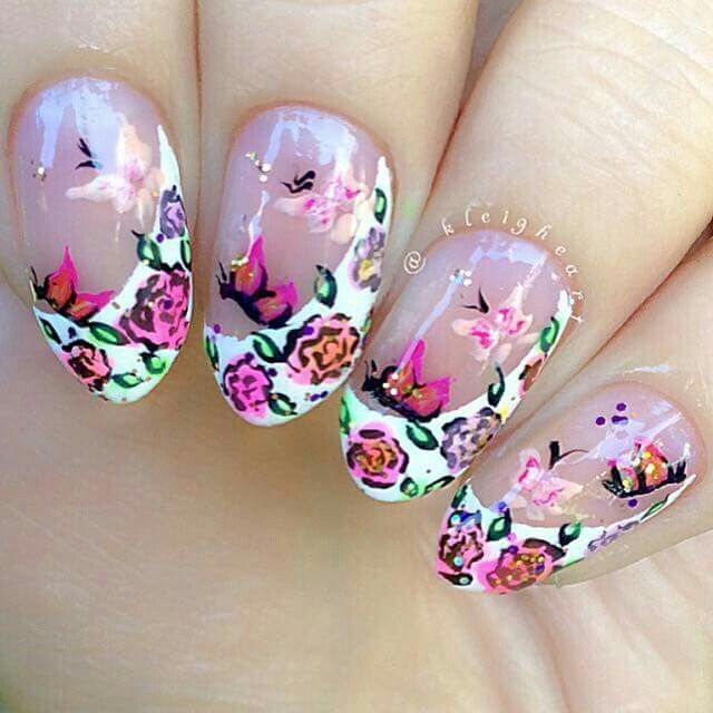 By @kleigheart Side swooping french tip with roses and butterflies hand painted.