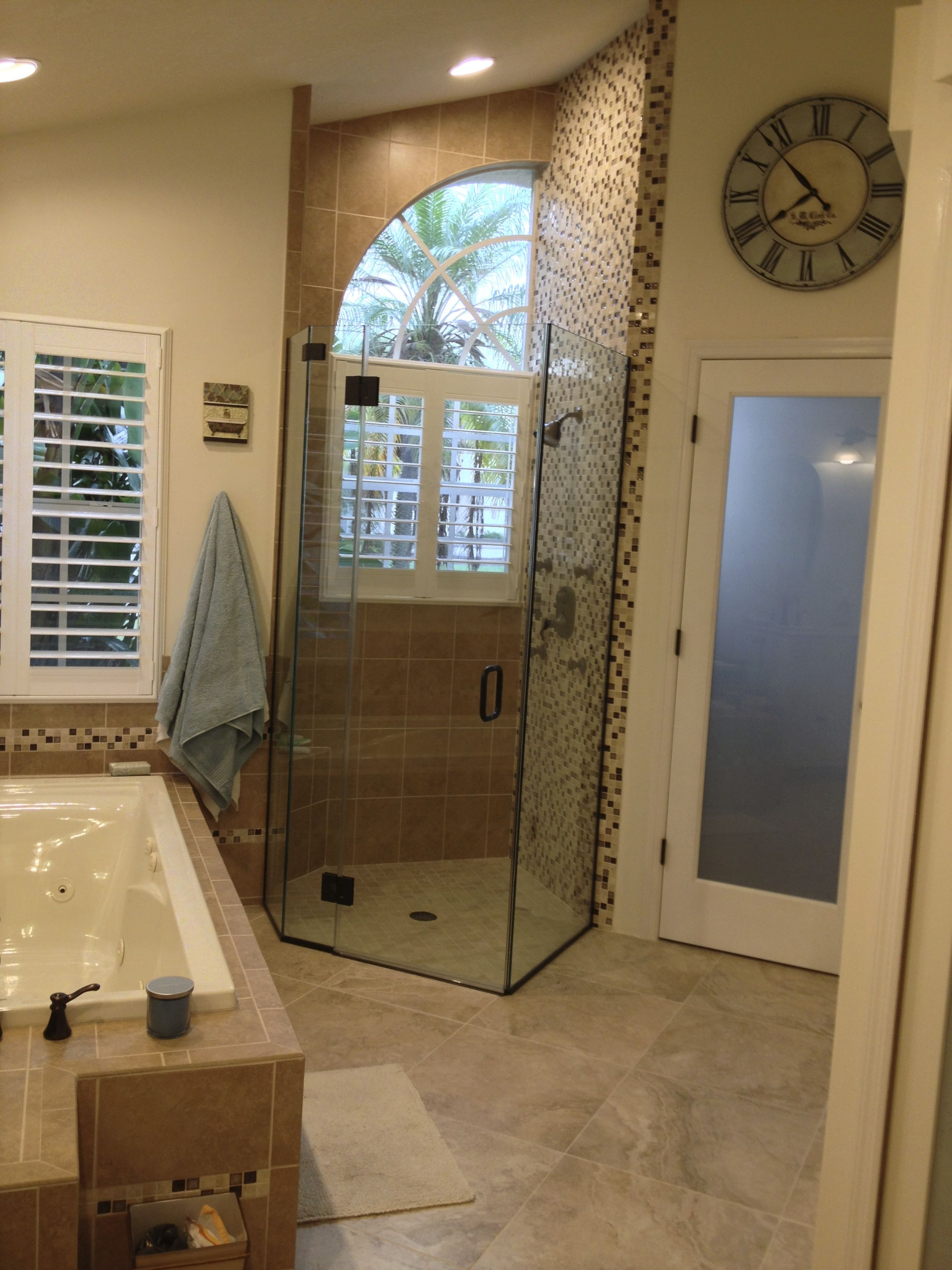 We tiled from floor to ceiling with an accent tile in the shower and ...