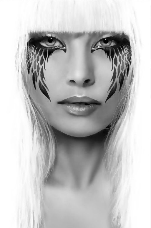 Dark Angel of Death:  It's not makeup, but it is very cool and a nice PHOTOSHOP effect.