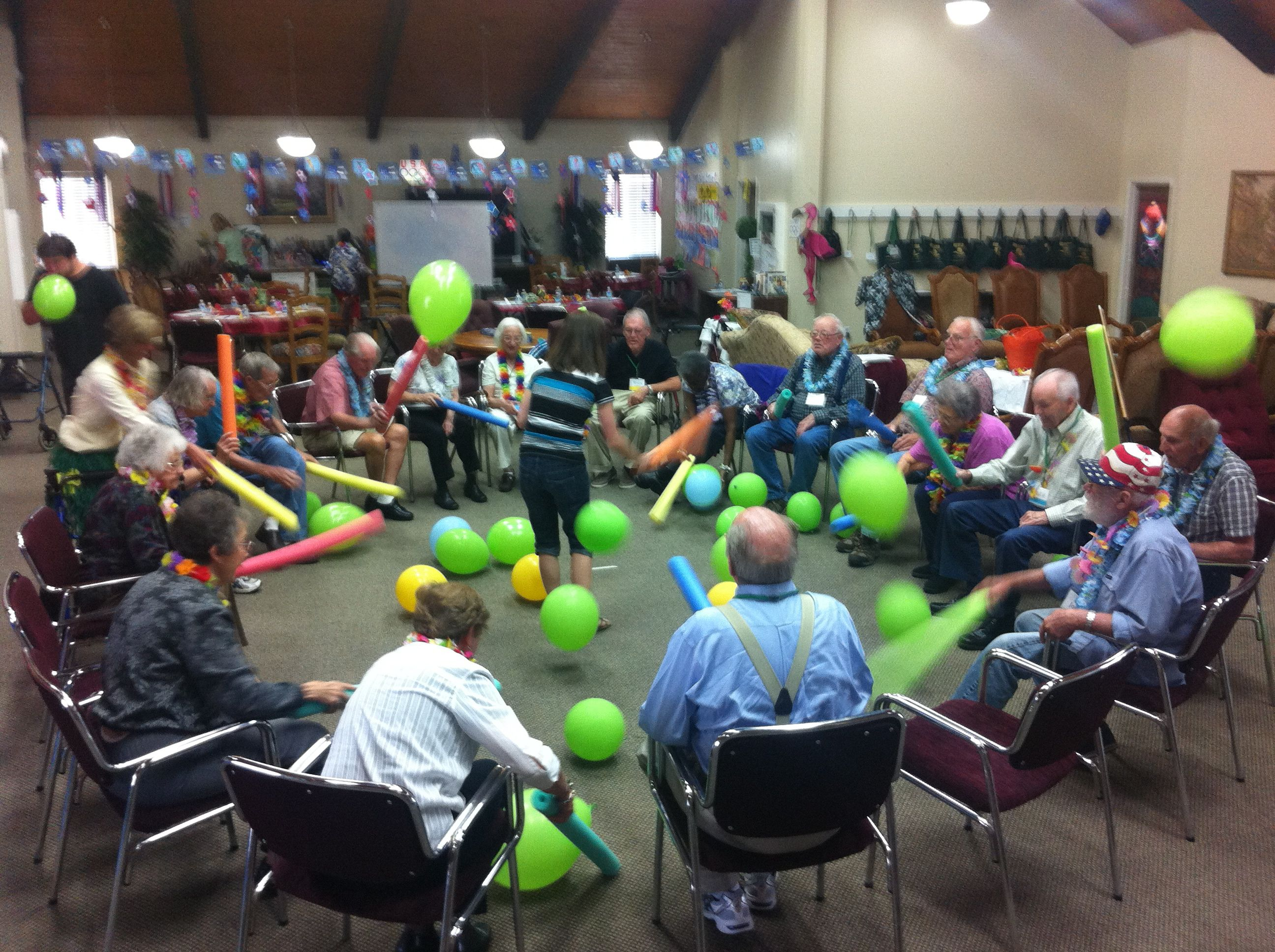 """Pool """"noodles"""" and balloons. Staying active and having fun"""