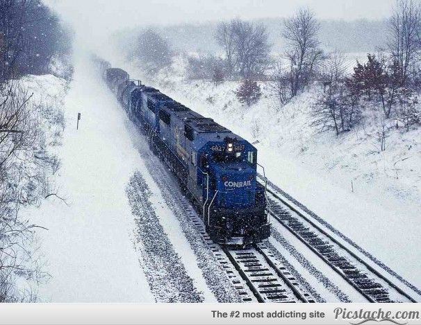 Stunning Photos Of Trains Plowing Through Winter Landscapes