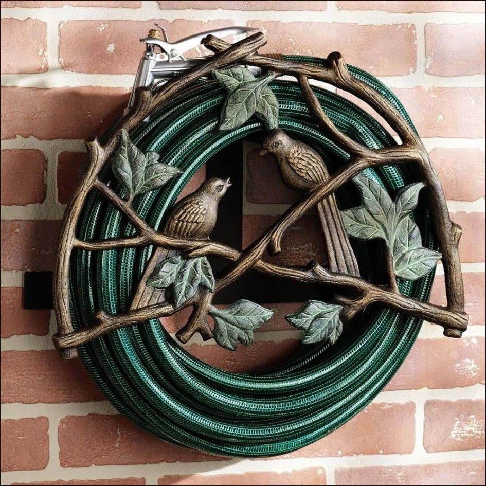 Decorative garden ornaments - Ideas Amazing Garden Hose Holder Made From Wrought Iron Materials And Have Decorative Designs With Birds Ornaments Garden Hose Storage