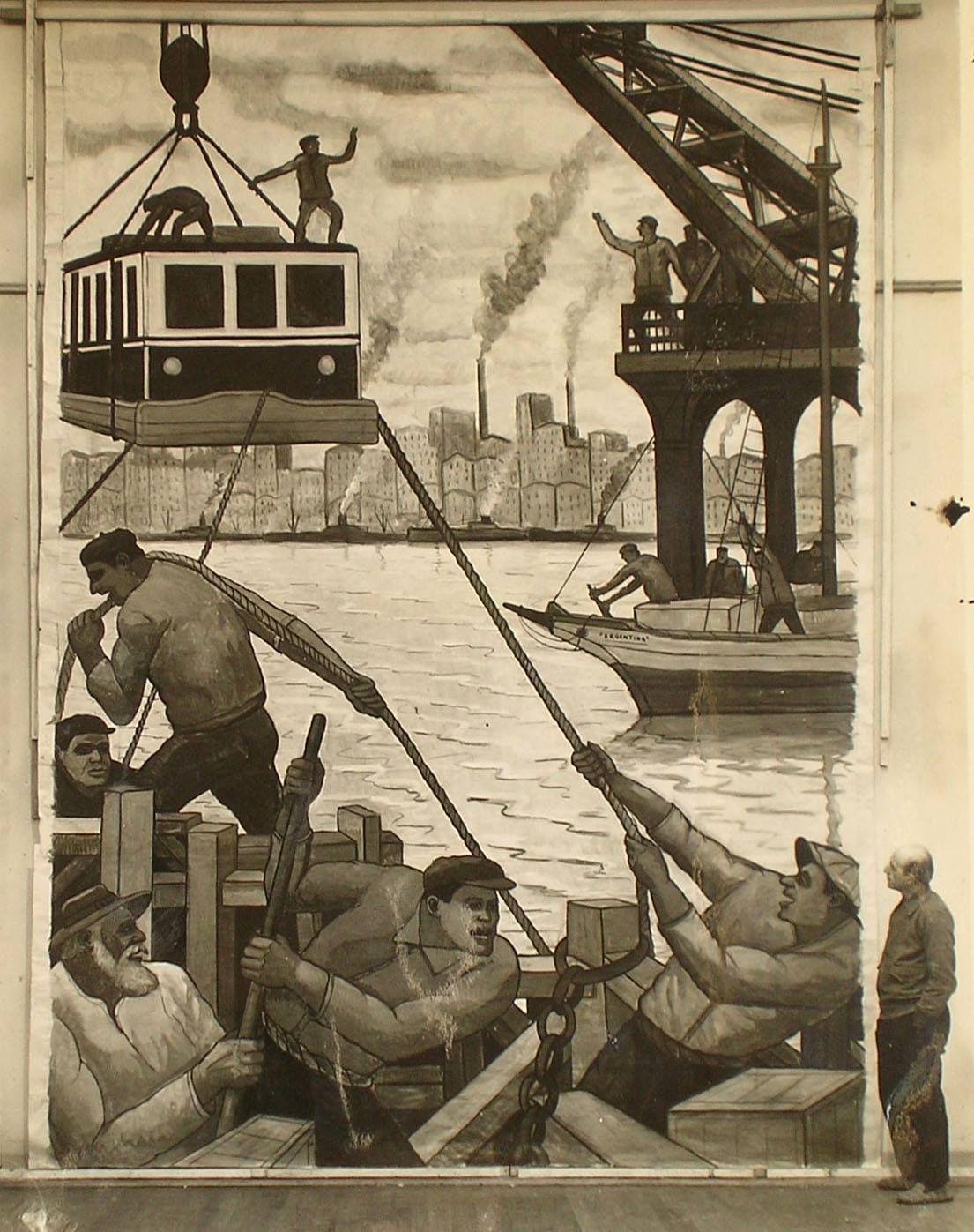 Benito Quinquela Martín, posando junto a su pintura 'Desembarques de tranvías', obra  para el mural del andén de la estación subterranea de 'Plaza Italia', BsAs, Argentina (1940)