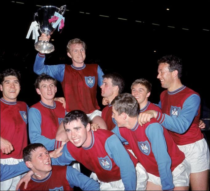EURO KINGS... West Ham captain Bobby Moore shows off the 1965 European Cup Winners' Cup trophy
