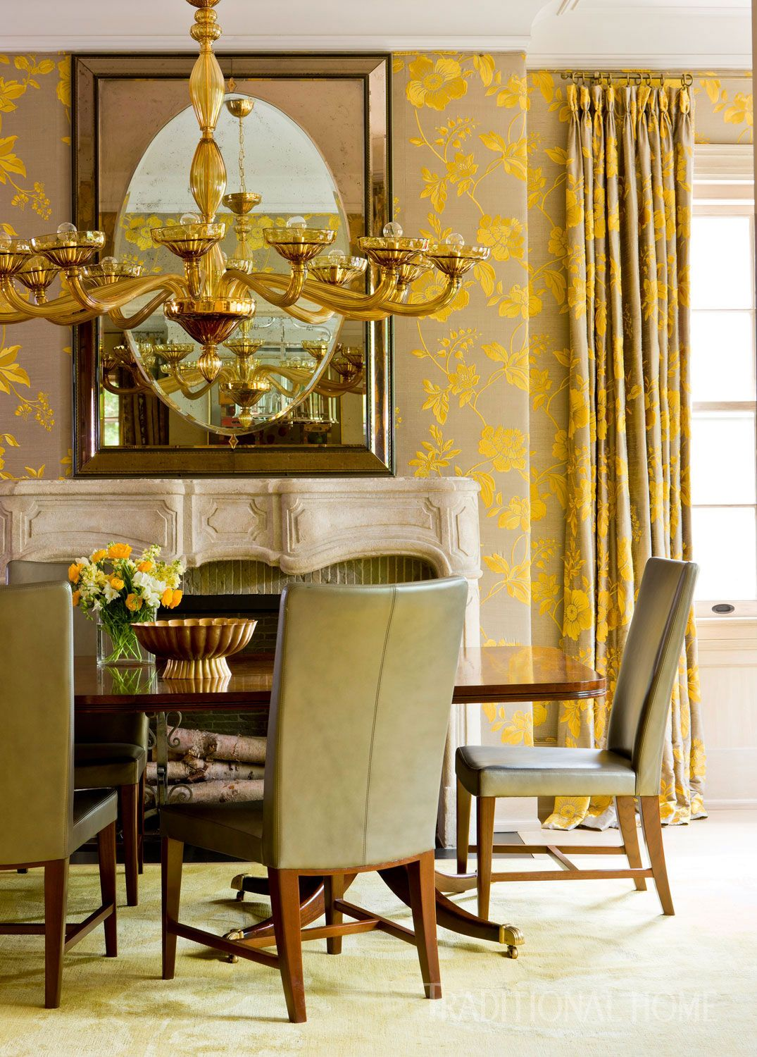 Holly Hunt chairs and a custom table are lit by a custom Venini ...