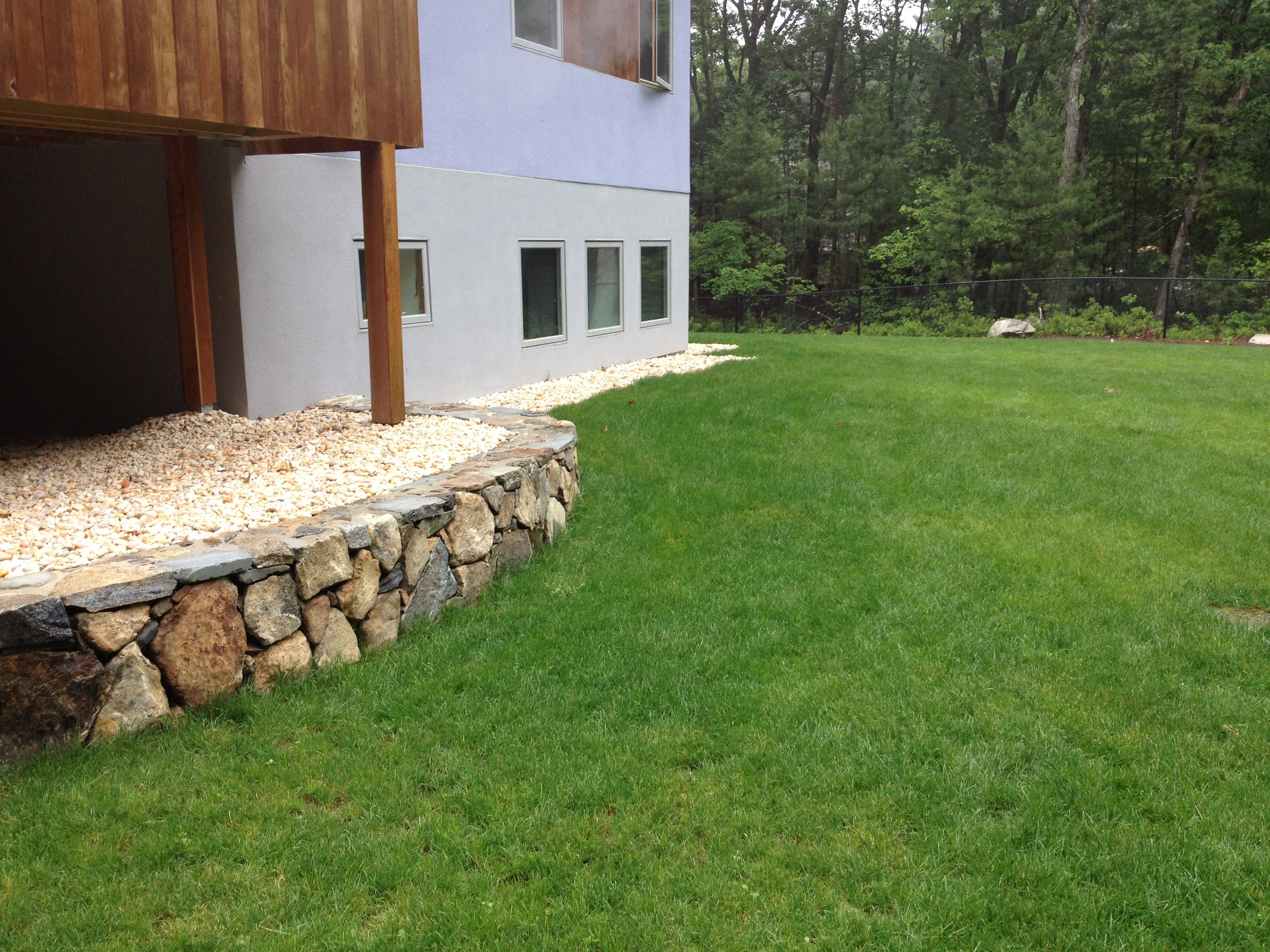 Fieldstone wall with mortared cap, backfilled with decorative stone