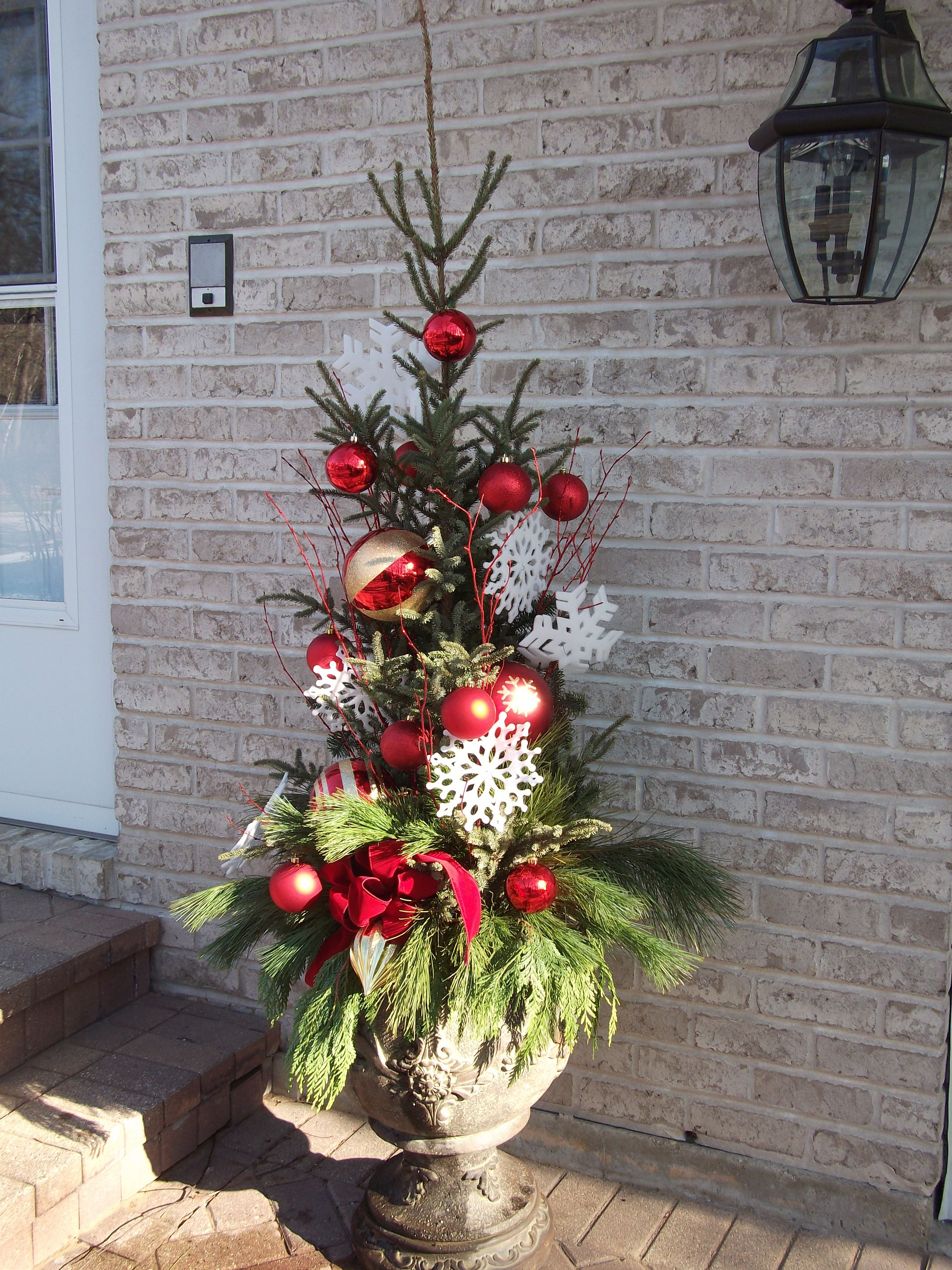 I love BIG ornaments for BIG impact at the side entrance.  This is one of a pair