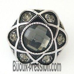 Bouton pression métal fleur noir et strass gris