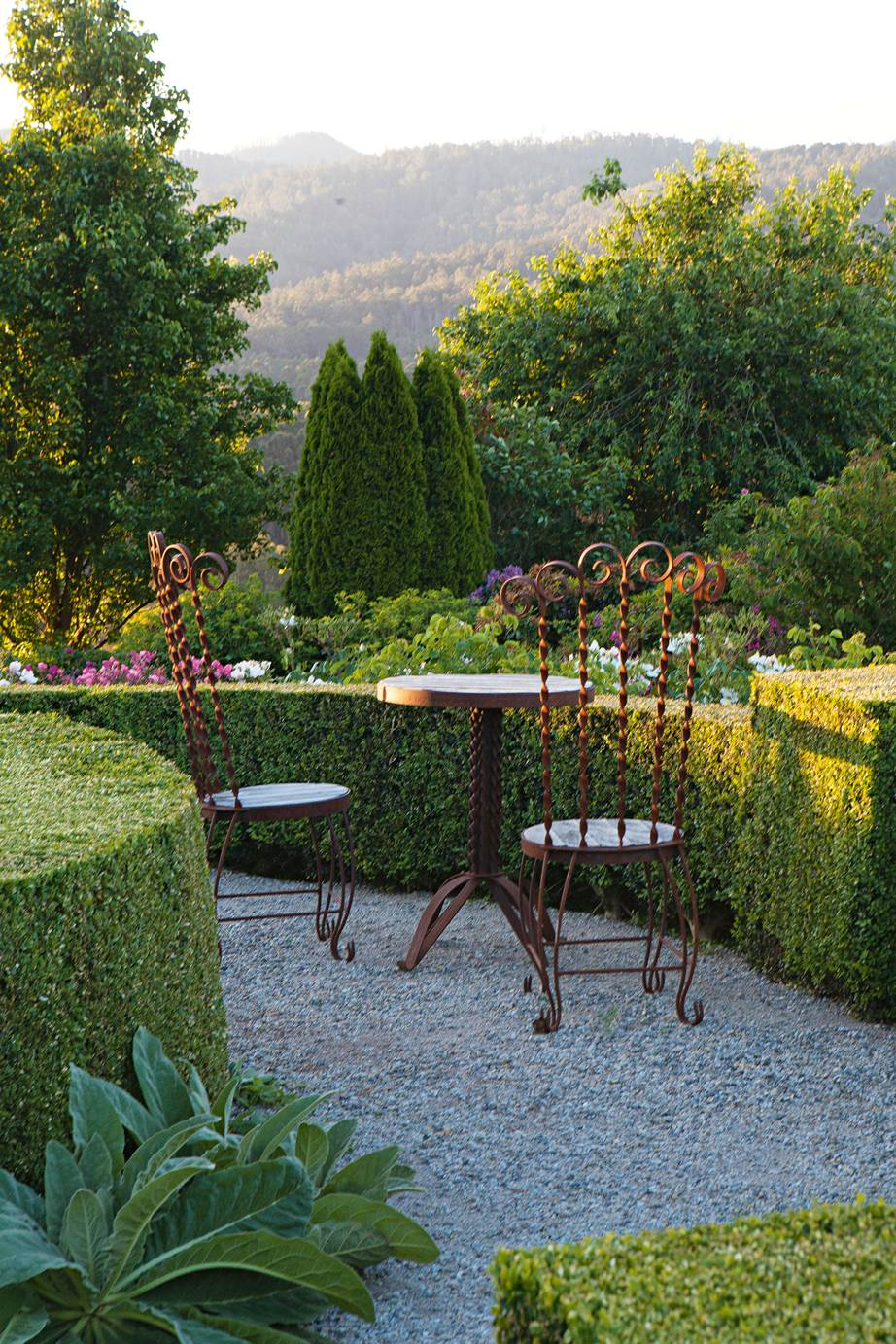 A tiered formal garden on a slope with magnificent views