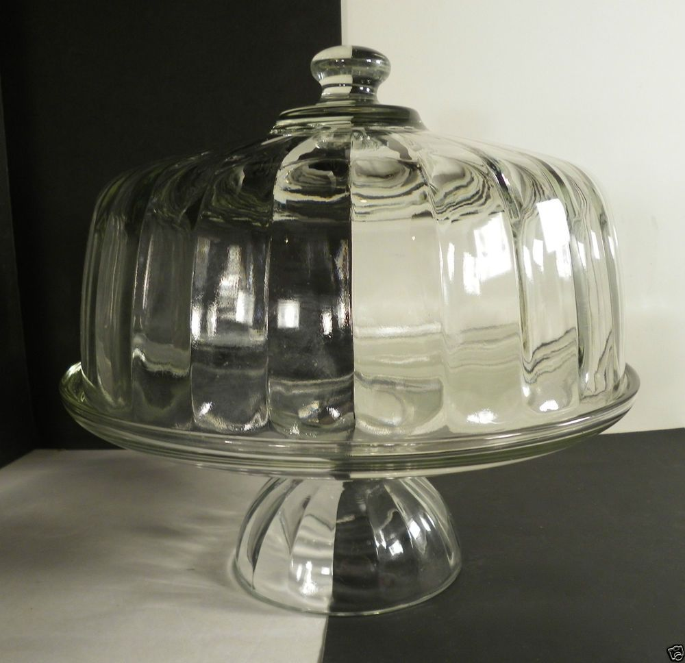Clear glass cake stand and dome cover paneled cupped base