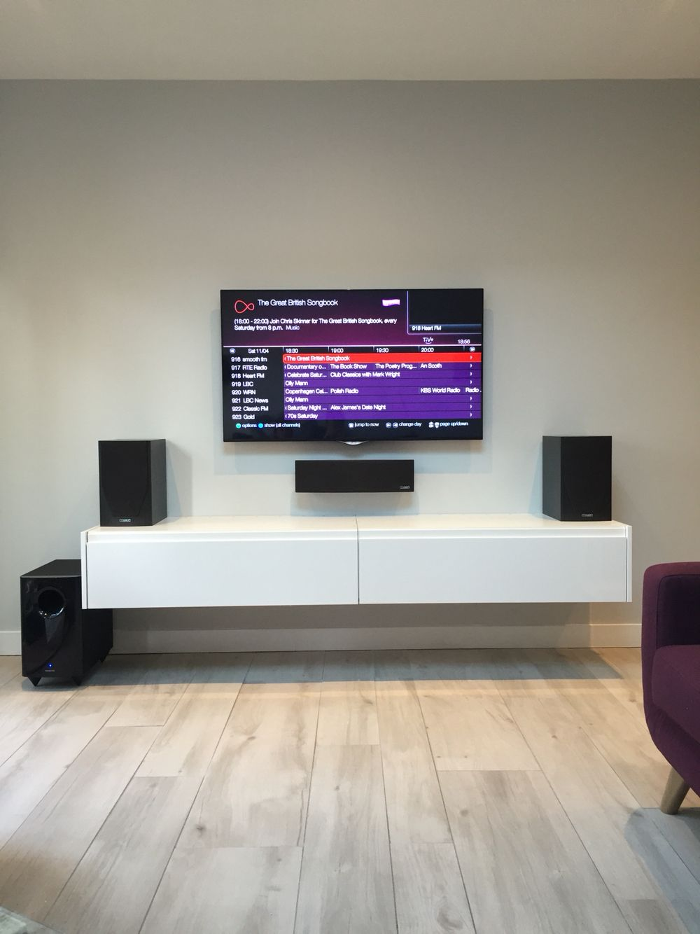 Simple White Wall Mounted Tv Cabinet Comprise Stained Wooden Drawer And Two Black Speaker Also Modern Led Design