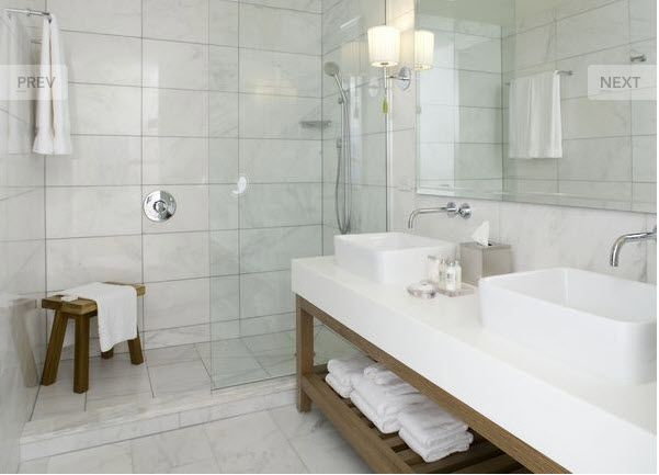 Marble Bathroom Designs | ... Large Subways In White Marble Adorn This  Handsome Traditional
