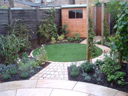 raised brick planters and limestone paving replace lawn to create an easy to maintain garden of - Garden Ideas To Replace Grass