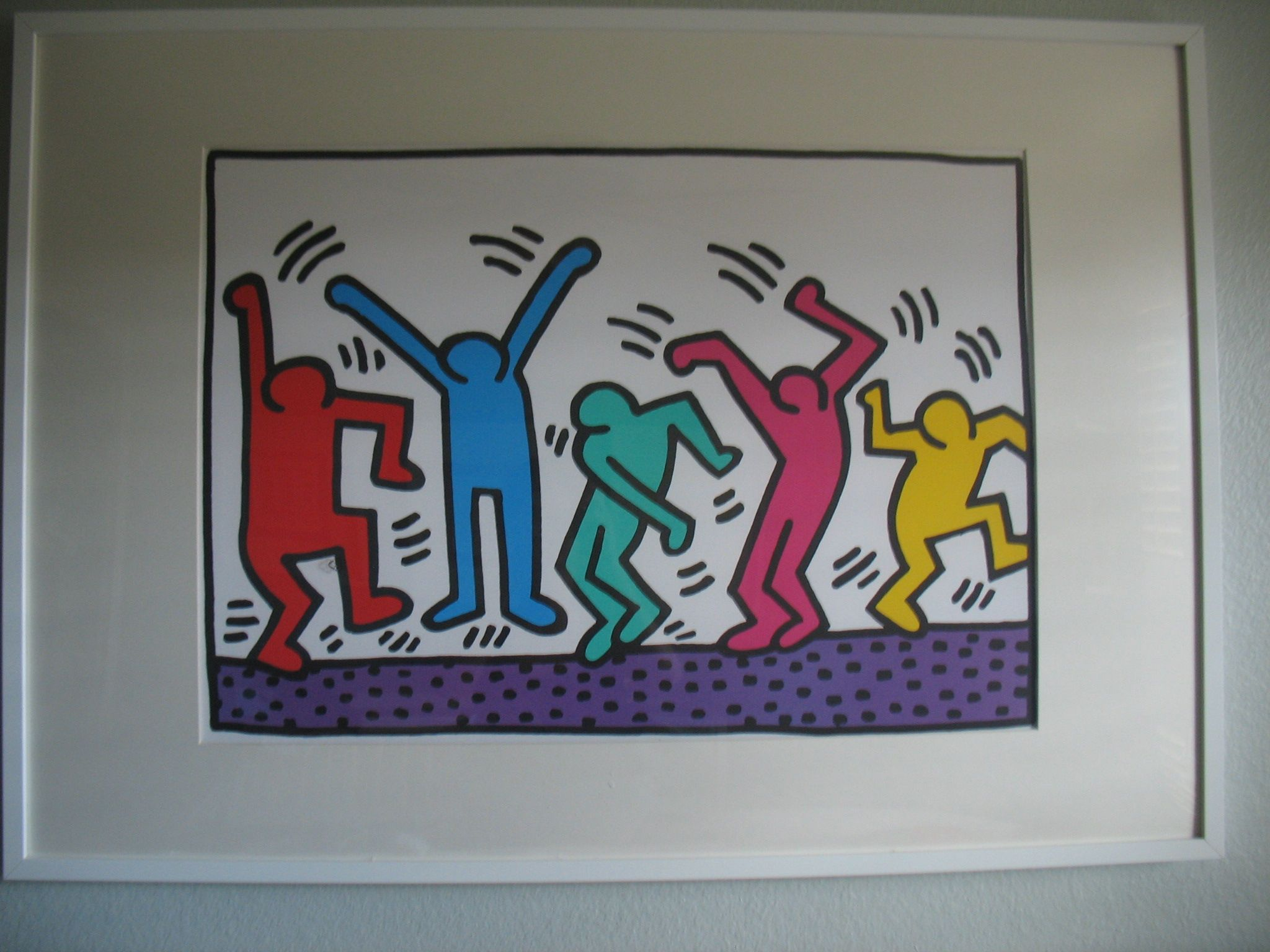 A must for any nursery above your babies changing table. We have this in our nursery and our baby loves it! Any Keith Haring art will do because of the abstract and bright colors.