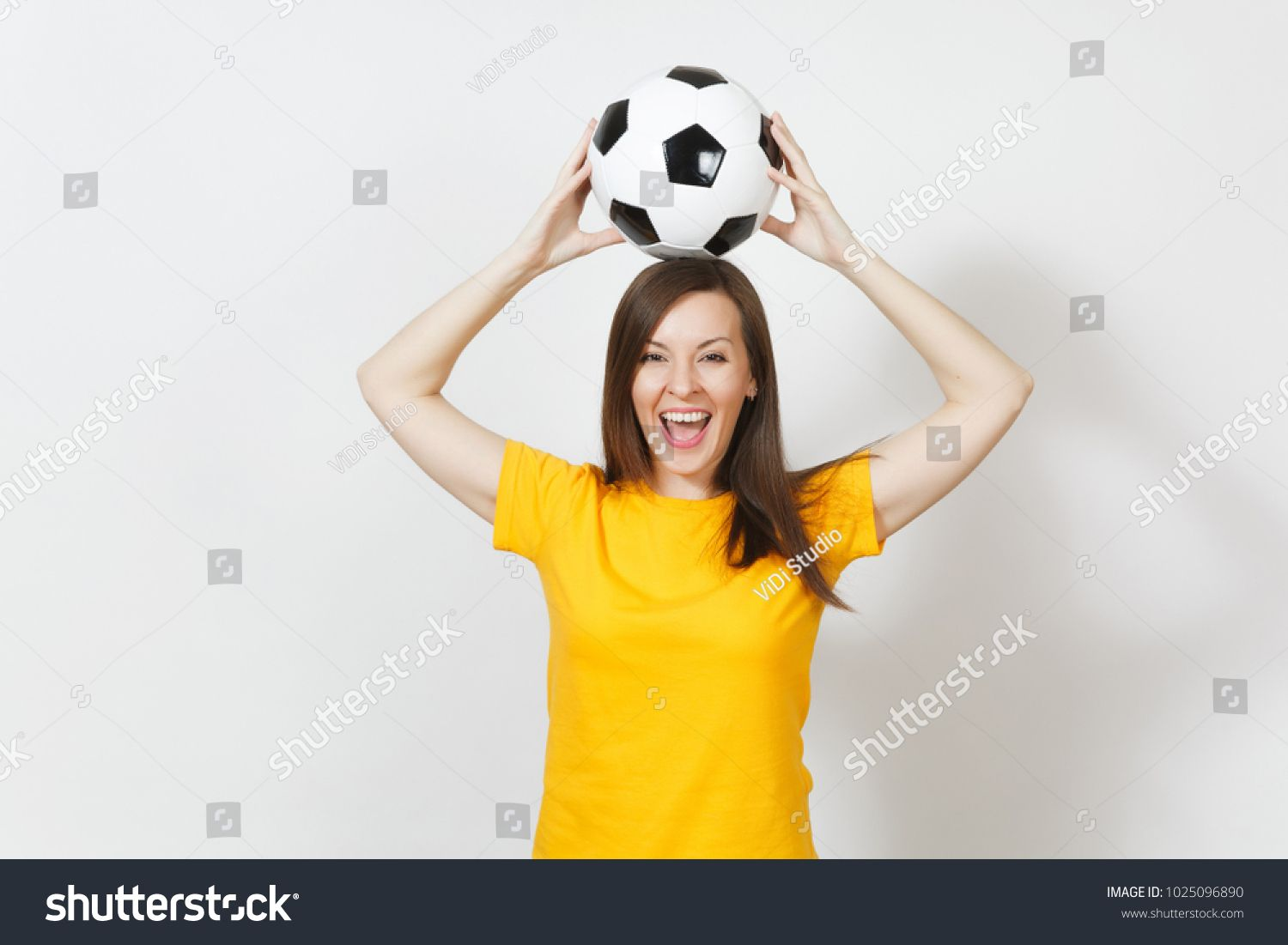 Beautiful European Young Cheerful Woman Football Fan Or Player In Yellow Uniform Holding Above Head Soccer Ball Isolated With Images Head Soccer Football Fans Soccer Ball