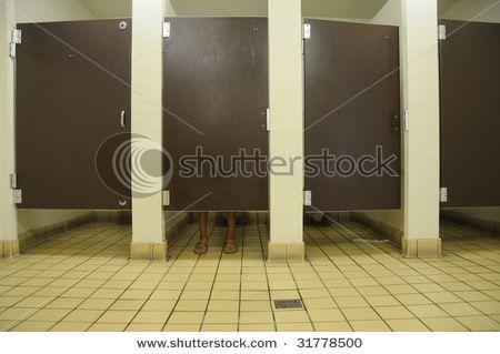 Stock Photo Feet Showing Under Bathroom Stall Door In Public