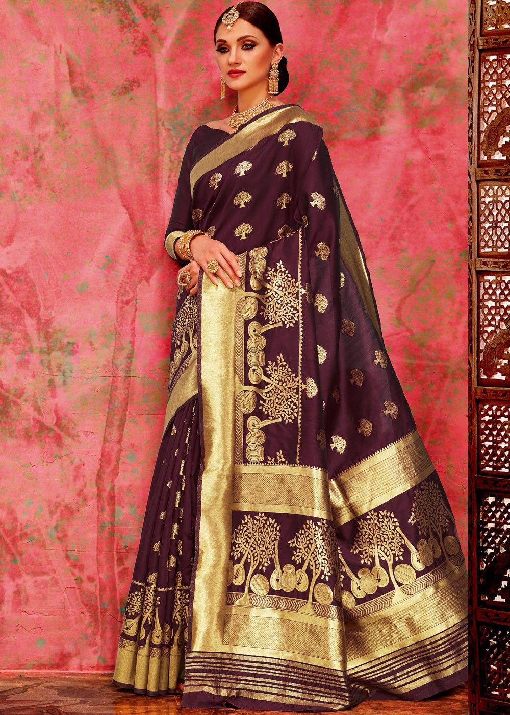 a607ba7e87e0a1 Dark  purple  banarasi  silk  saree enhanced by all over foil print with  distinctive  pallu design and heavy border throughout.