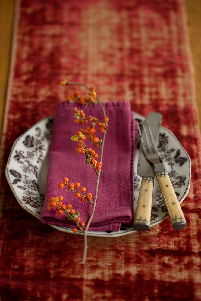 wabi sabi table setting - worn velvet table runner, vintage plate, knife and fork and dressed with a berry laden twig   #wabisabi