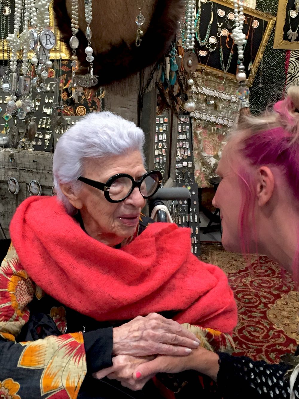 Iris Apfel talking to jewelry designer, Amy