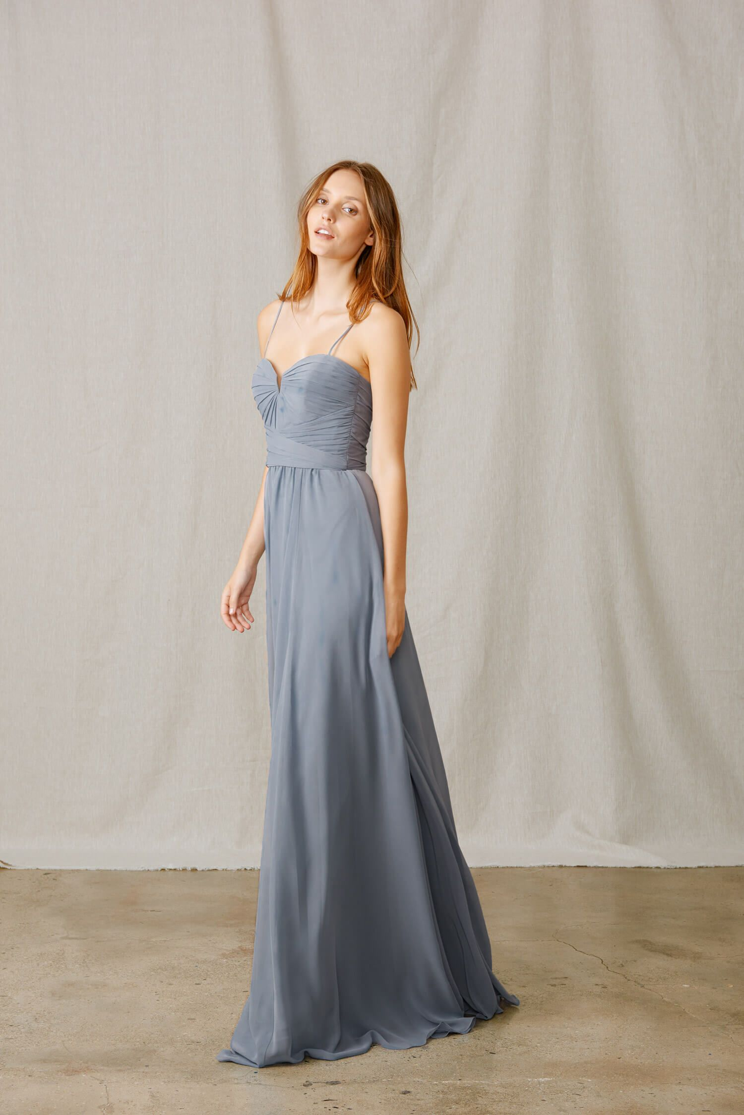 09486d522be Amsale  260.00 Bella Bridesmaids Exclusive style. Spaghetti strap Flat  Chiffon gown with notched V neckline. Wraps at the waist with long flowy  skirt.
