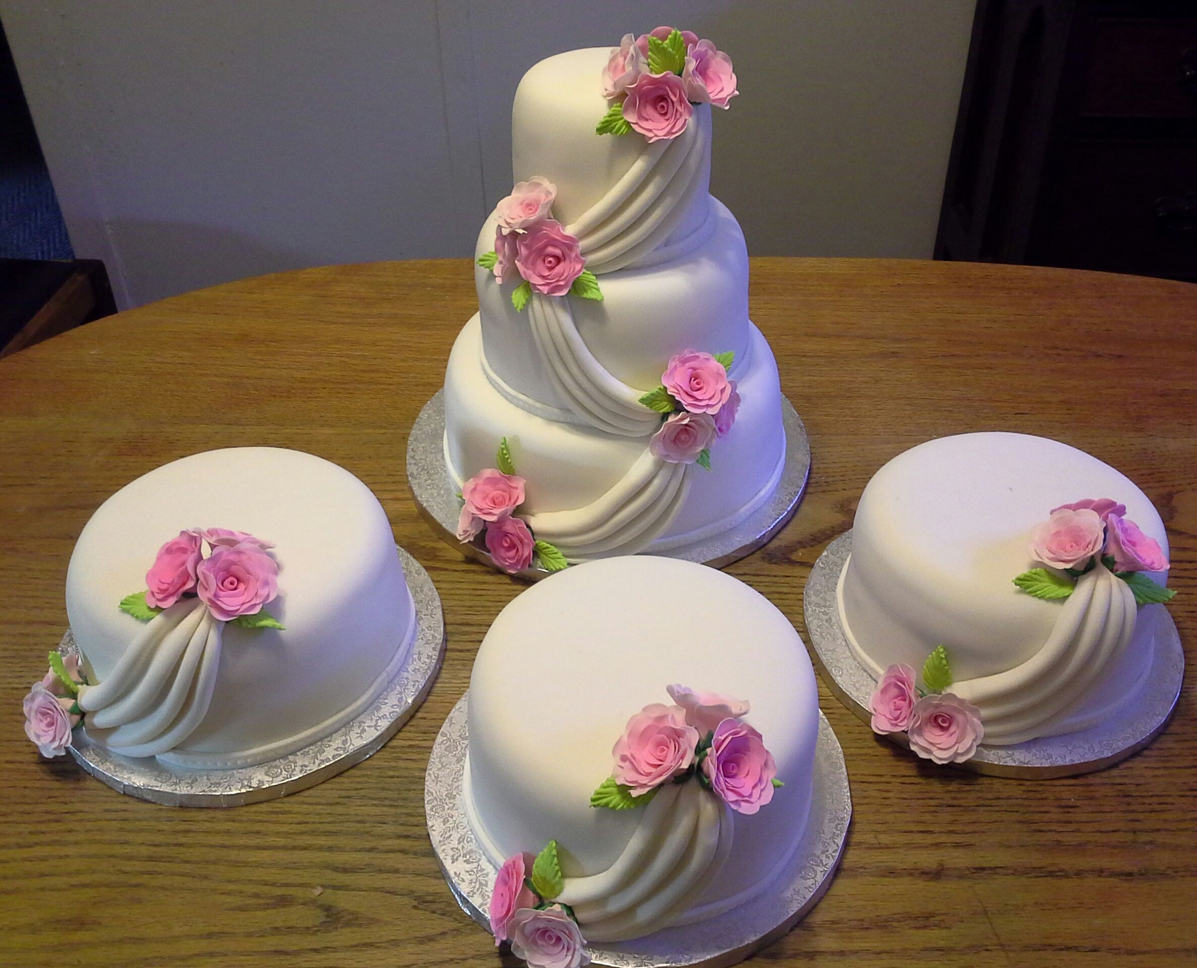 Wedding cake with 3 side cakes.