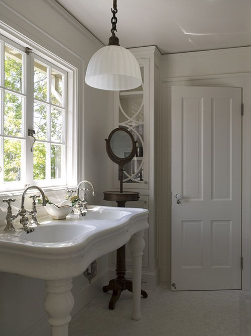 Gorgeous Bathroom With Double Parisian Pedestal Sink And Ivory