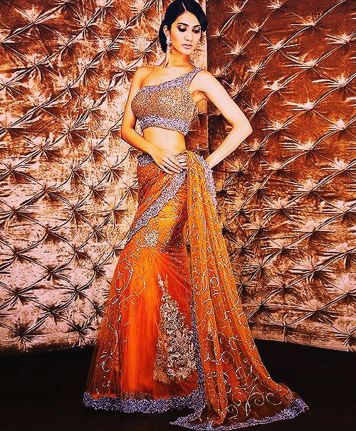 Diggin the orange lengha choli - gorgeous one shoulder blouse!