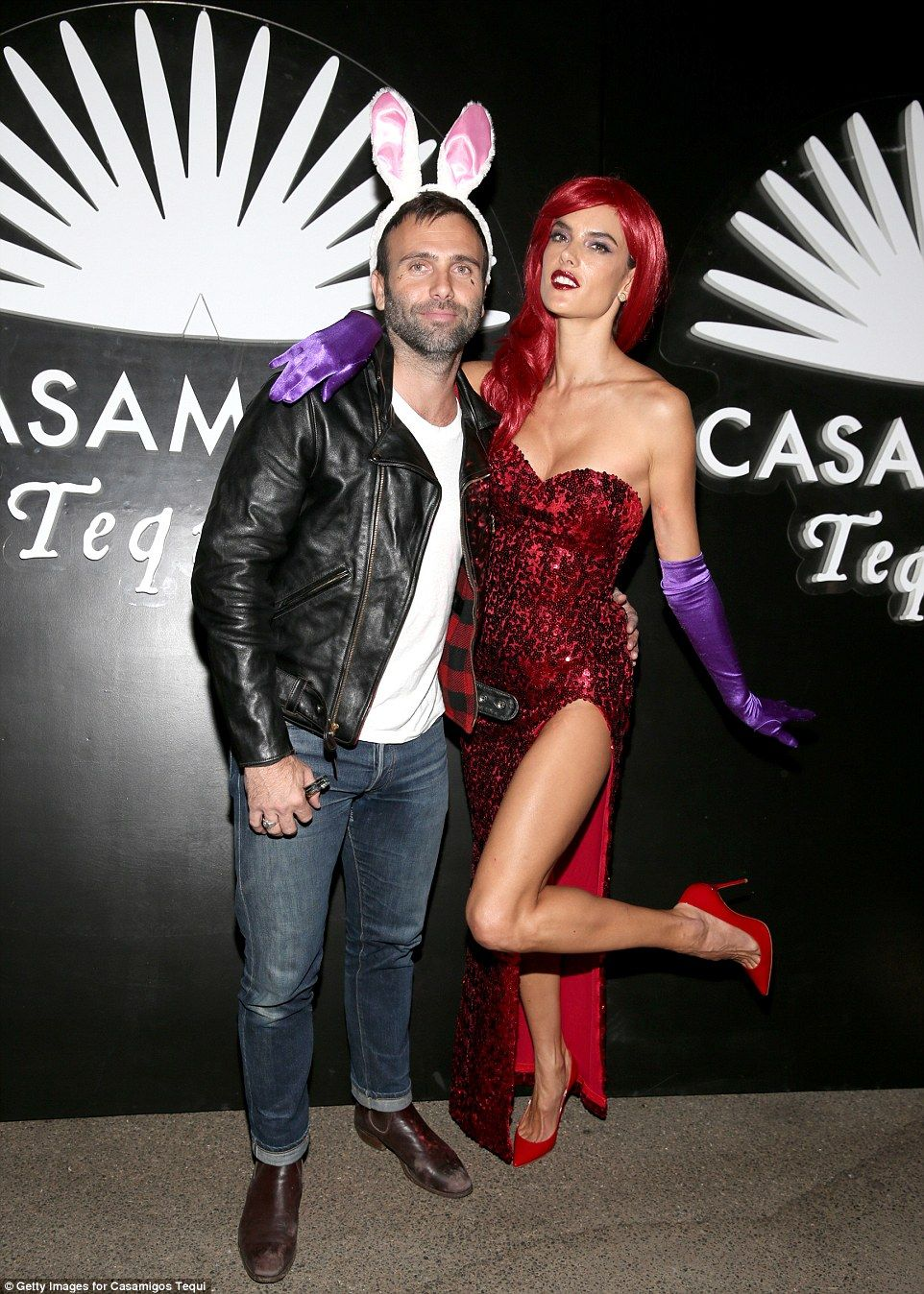 Victoria's Secret model Alessandra Ambrosio drew inspiration from Heidi Klum's costume last year as she channeled Jessica Rabbit, while her fiance Jamie Mazur dressed down in a leather jacket and blue jeans