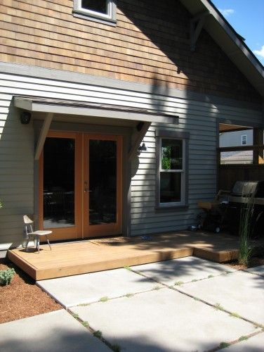 Henry St House Traditional Exterior By Conscious Construction Inc Traditional Exterior Patio Doors Wood Exterior Door