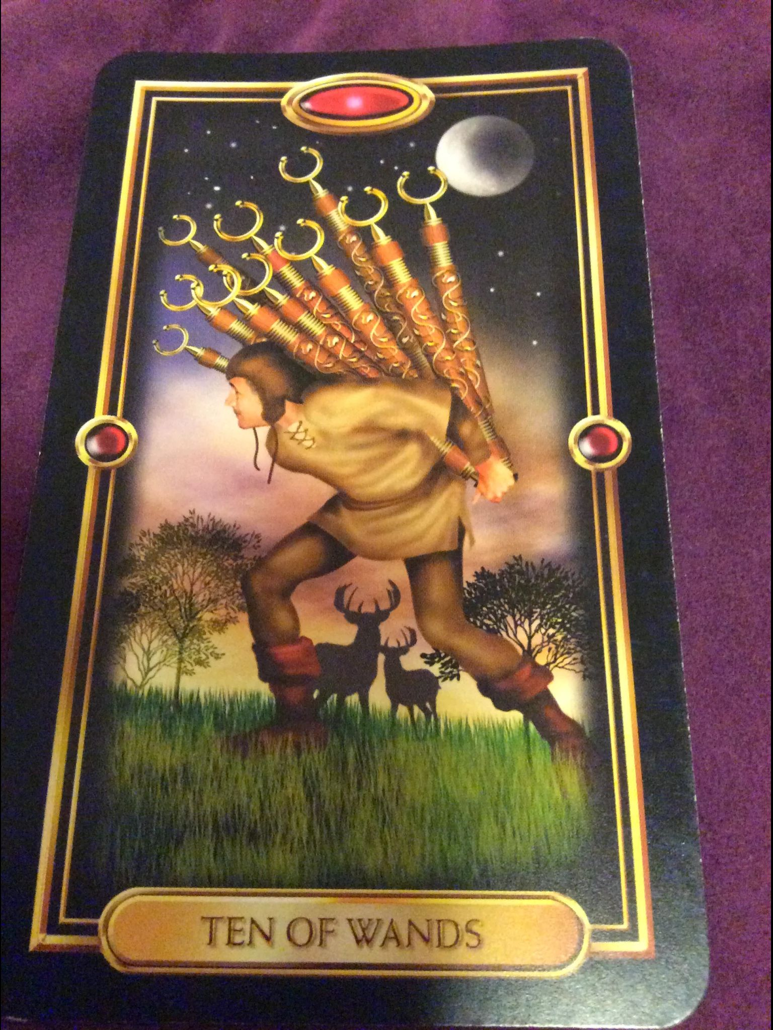 10 of wands from the gilded tarot deck by ciro marchetti