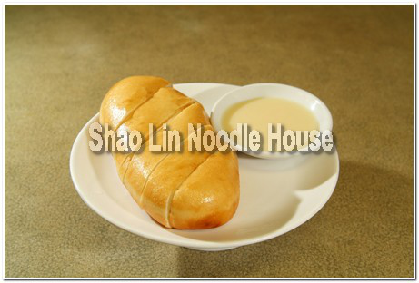 Because we're a traditional Chinese restaurant, we of course have deep-fried rolls with condensed milk dip on our menu. It doesn't look like much, but once you've tried it, you will want more!