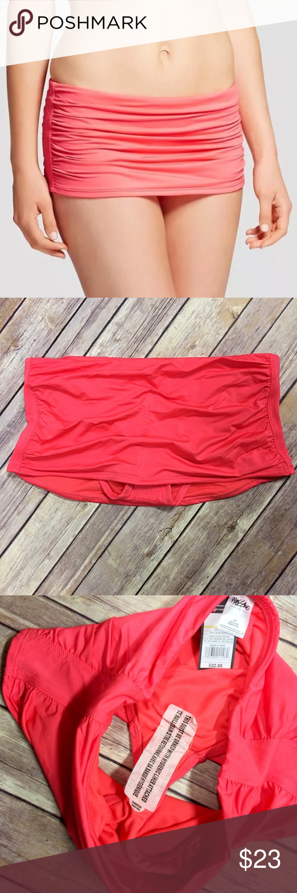 """Xhilaration Retro Ruched Coral Swim Skirt Small Make retro style modern in the Mossimo Shirred Skirt. This classic fit is shirred at the front and back and sits comfortably at the hips. This trendy bottom offers full coverage.  Item Specifics: Brand: Mossimo for Target Orig Price: $22.99 Style#: M05976 Color: Coral Island New with Tags: Yes Materials: 90% nylon, 10% spandex   Sizing Info from Website: Size: Small - 4/6 Waist: 27.5"""" - 28.5"""" approx Hips: 37"""" - 38"""" approx Xhilaration Swim…"""