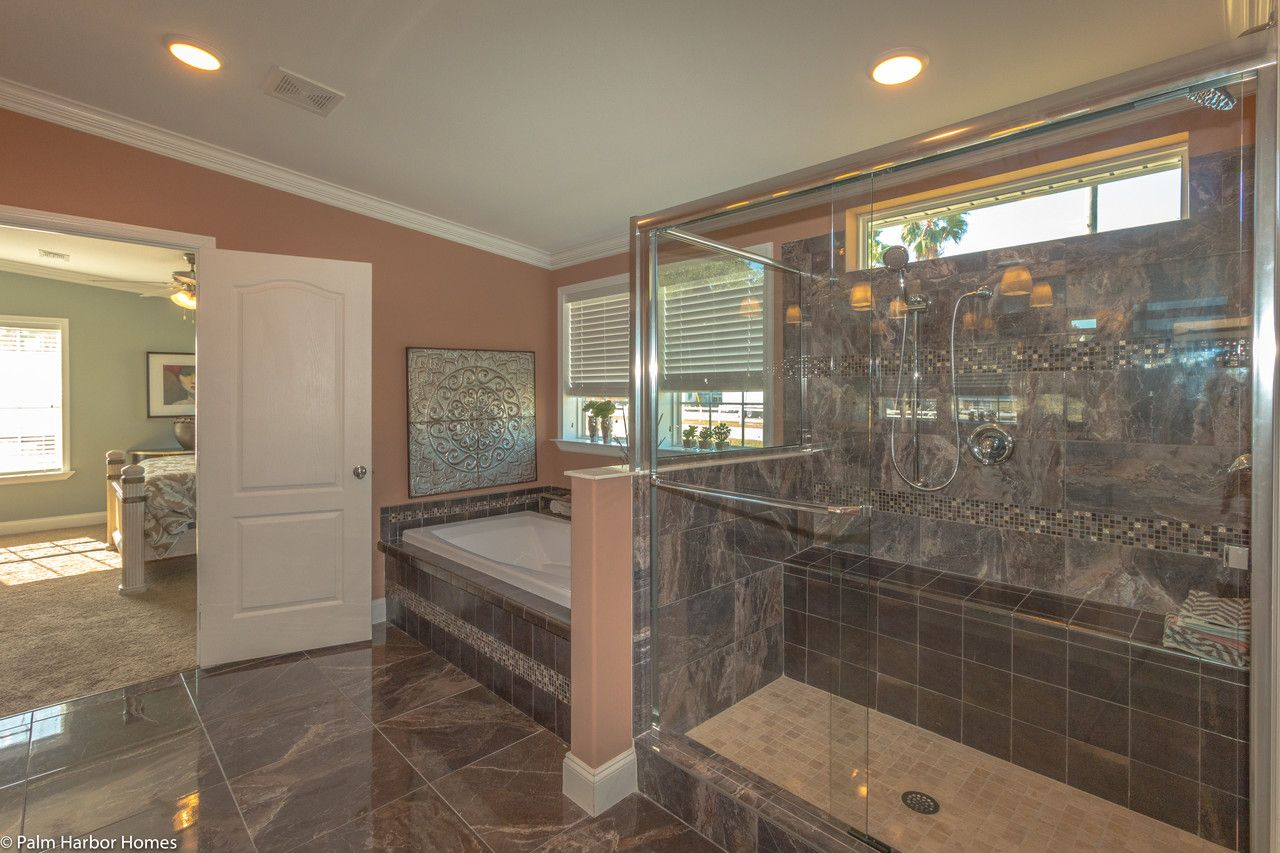 Massive walk in shower AND tub plus a separate commode