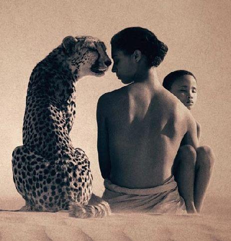woman boy and cheetah