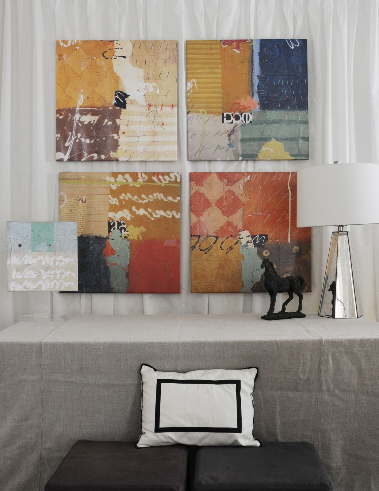 Four colorful paintings in a living room. Adele Sypesteyn www.adelesypesteyn.com