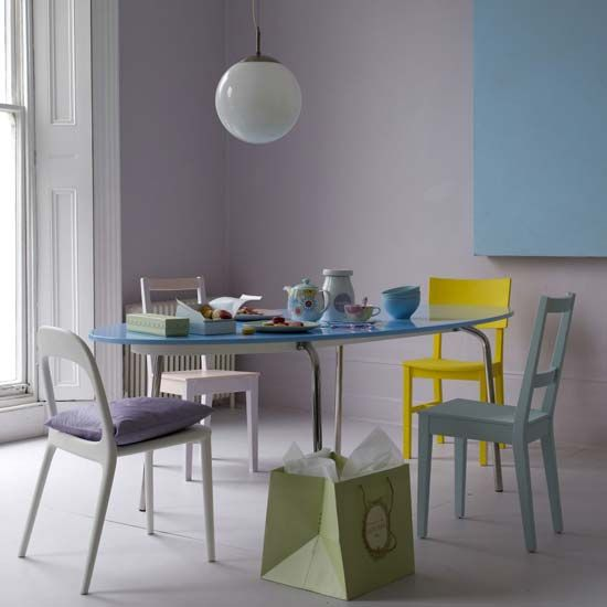 dramatic purple dining room designs in pastels | The split complementary colors in this room are yellow and ...