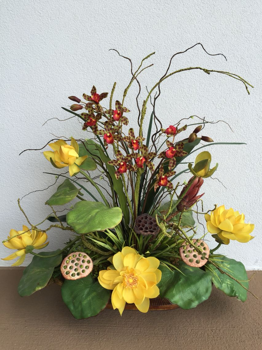 Yellow lotus arrangement designed by Arcadia Floral & Home