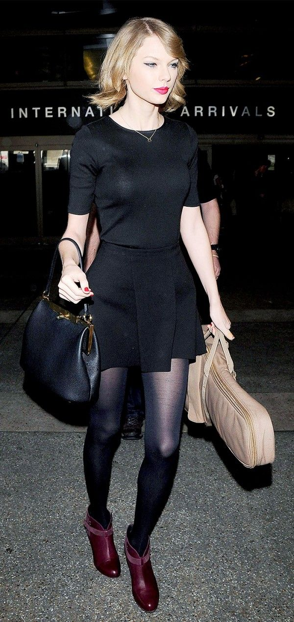 cdc73b971175 Taylor Swift wears a black t-shirt and circle skirt with black tights and  red