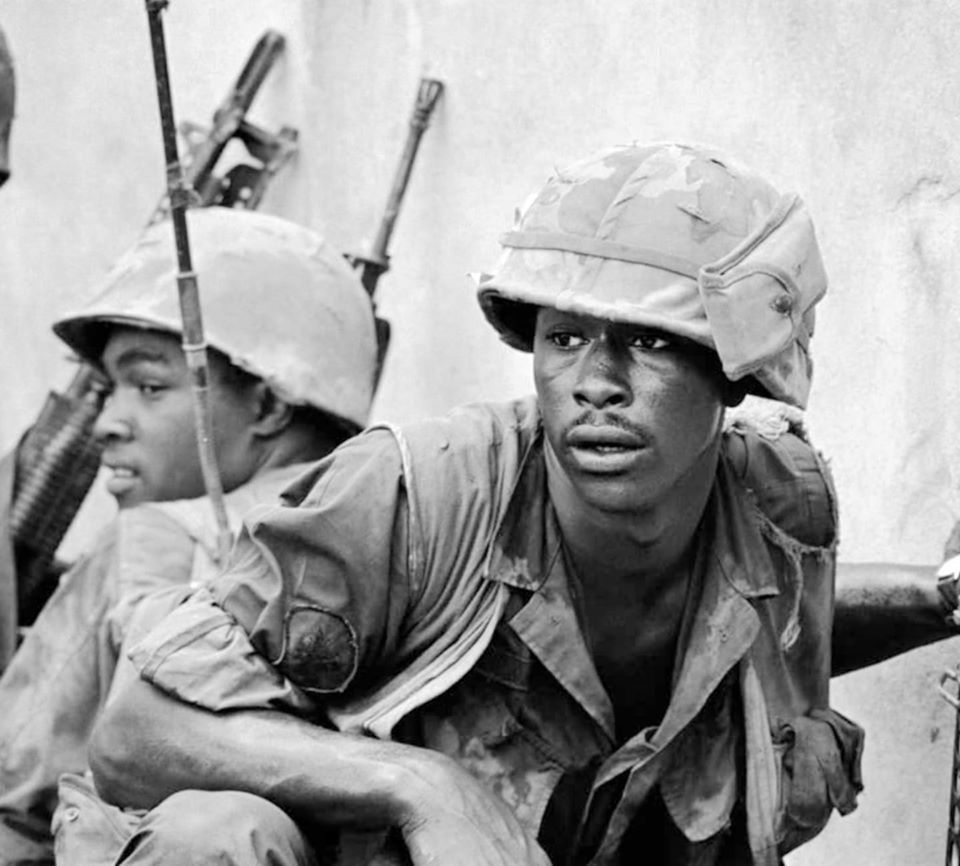 The battle for Saigon. Marines crouch at a wall during Tet