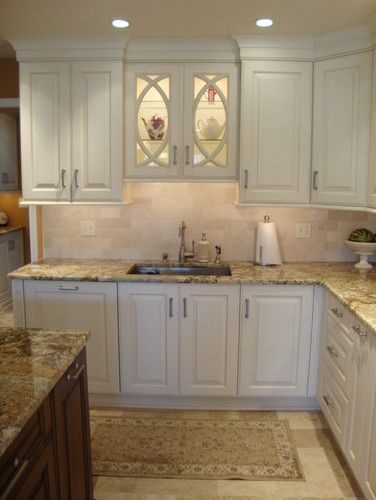 glass kitchen cabinet doors above stove would be cute to display old cookbooks in kitchen on kitchen decor over sink id=79943