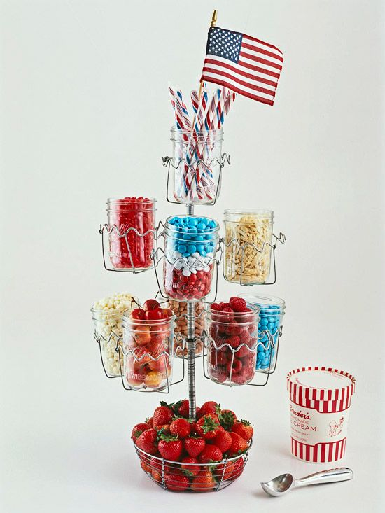 Create the ultimate sundae bar by arranging glass canning jars filled with ice cream toppings on a tiered stand.