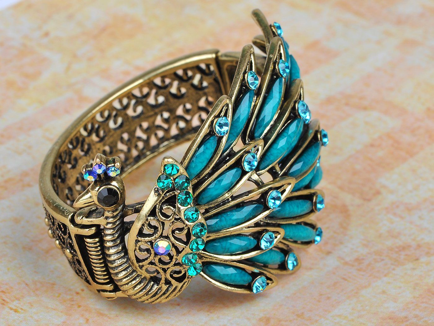 Amazon.com: Golden Blue Beads Crystal Rhinestone Gems Side Profile Peacock Bracelet Bangle: Jewelry