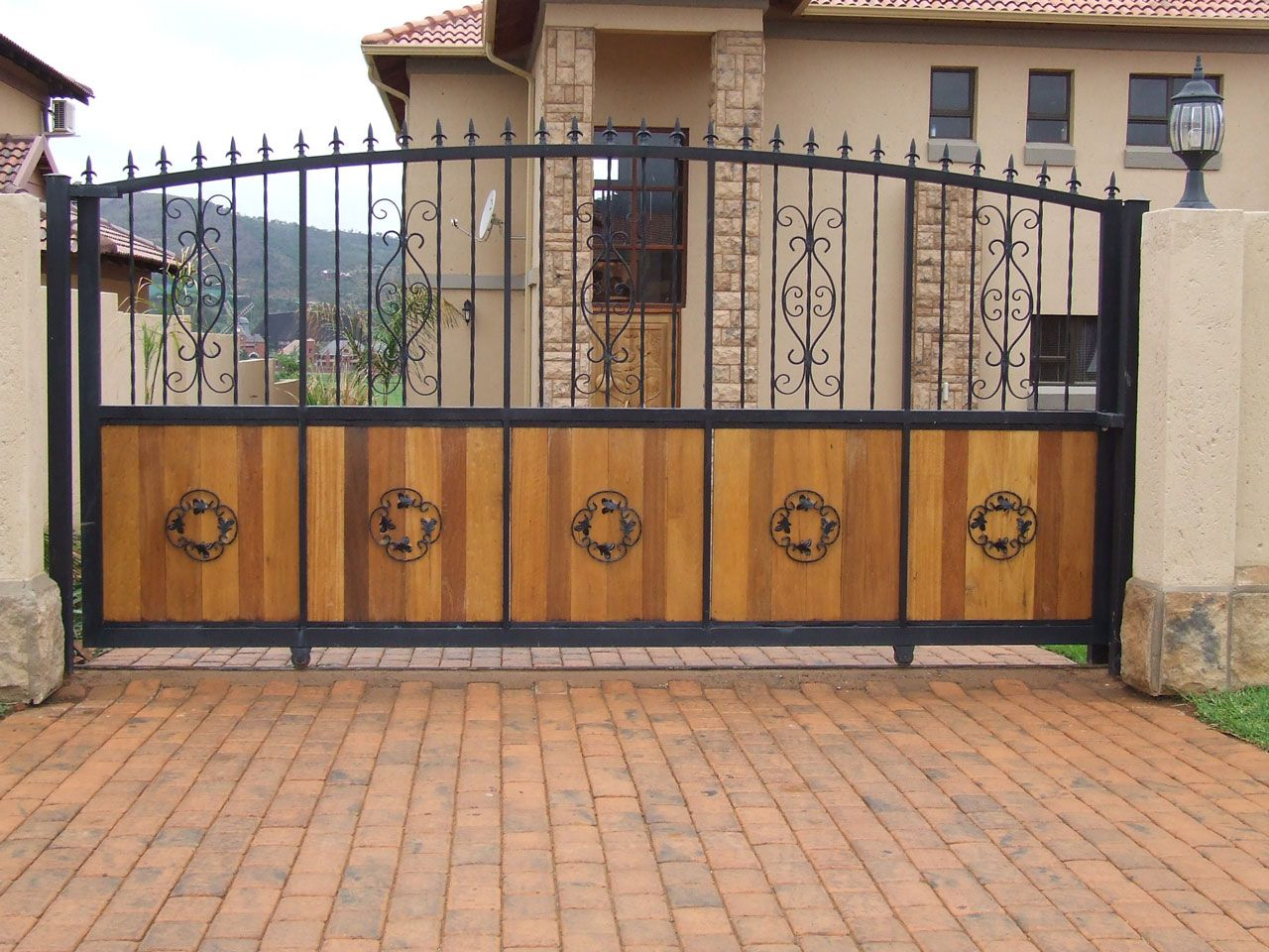 Brick Driveway Idea feat Contemporary Wrought Iron and Wood ... for Contemporary Iron Gate Designs  288gtk