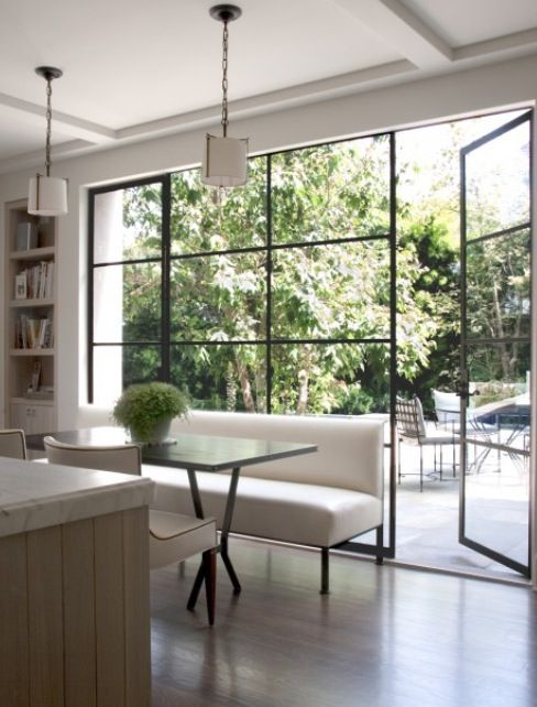 Great Light Coming From The Floor To Ceiling Glass Doors In This Breakfast Room With A Patio Right Outside